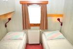 Slaapkamer met 2 éénpersoonsbedden